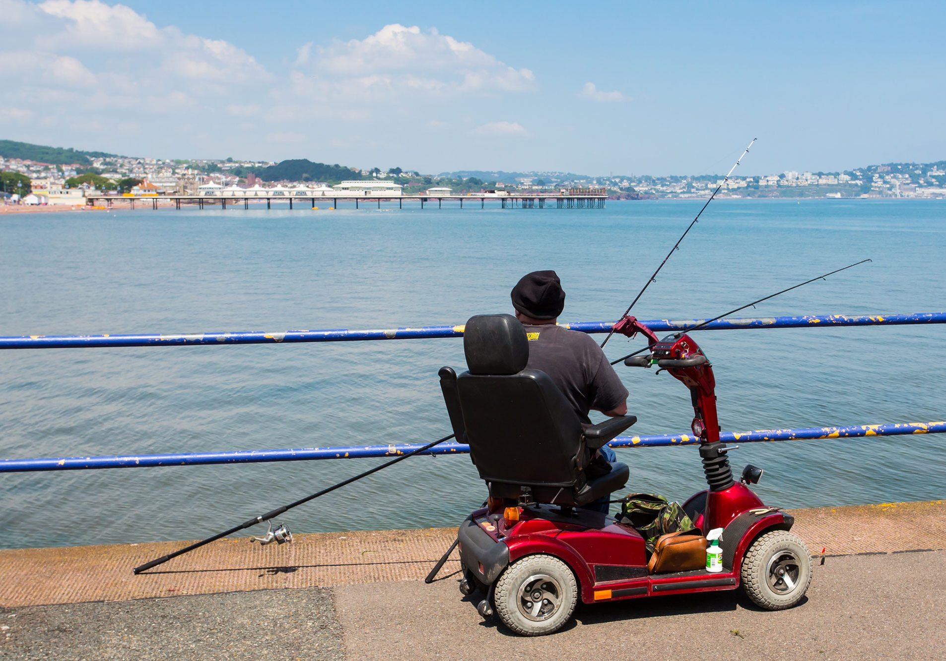 Man fishing on mobility scooter